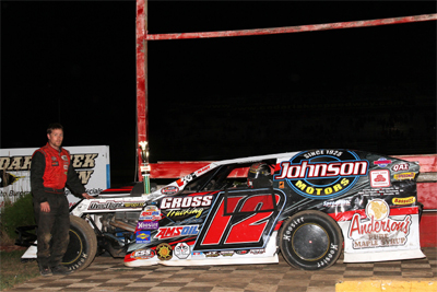 Jason Gross in victory lane at the Cedar Lake in August 2012.